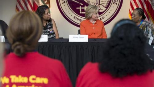 Democratic presidential candidate Hillary Clinton (C) participates in a Service Employees International Union roundtable on Home Care at Los Angeles Trade-Technical College in Los Angeles, California August 6, 2015. REUTERS/Mario Anzuoni