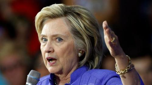 Democratic presidential candidate Hillary Rodham Clinton announces her college affordability plan, Monday, Aug. 10, 2015, at the High School in Exeter, N.H. (AP Photo/Jim Cole)
