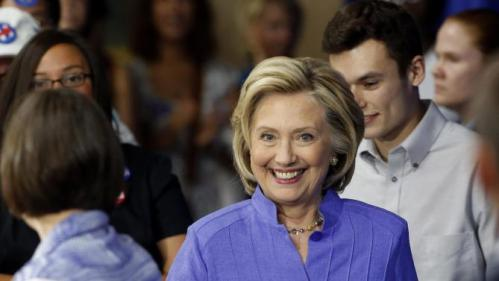Democratic presidential candidate Hillary Rodham Clinton arrives at the high school in Exeter, N.H., Monday, Aug. 10, 2015, where she announced her college affordability plan.  (AP Photo/Jim Cole)