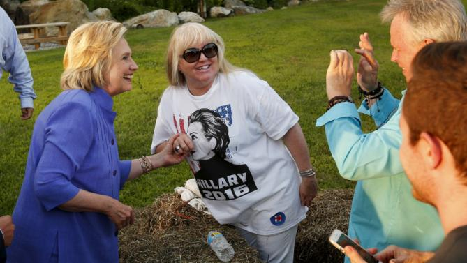 "U.S. Democratic presidential candidate Hillary Clinton poses for a photograph with Mary McDermott, who is wearing a ""Hillary 2016"" t-shirt, at a campaign stop in Manchester, New Hampshire, August 10, 2015. REUTERS/Brian Snyder"