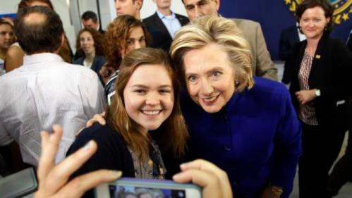 Democratic presidential candidate Hillary Rodham Clinton poses for a photo during a campaign stop at River Valley Community College Tuesday, Aug. 11, 2015, in Claremont, N.H. (AP Photo/Jim Cole)