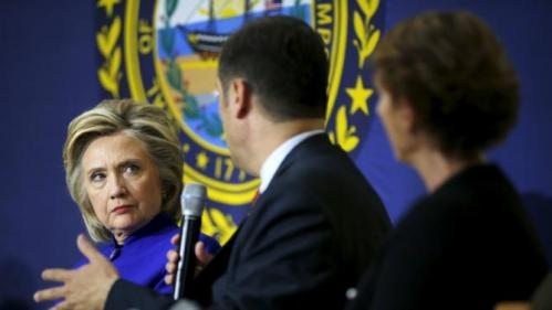 U.S. Democratic presidential candidate Hillary Clinton (L) listens as Jose Montero (C) speaks during a community forum about substance abuse in Keene, New Hampshire August 11, 2015.   REUTERS/Brian Snyder