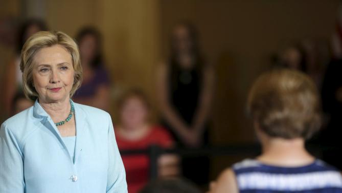 United States Democratic presidential candidate Hillary Clinton listens to a question from a woman in the audience during a town hall meeting about college affordability in Dubuque, Iowa August 14, 2015. REUTERS/Joshua Lott