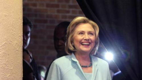 Democratic presidential candidate Hillary Rodham Clinton waits to speak at the at the Iowa Democratic Wing Ding at the Surf Ballroom Friday, Aug. 14, 2015, in Clear Lake, Iowa. (AP Photo/Charlie Riedel)