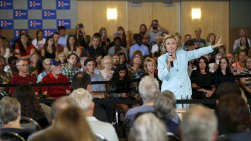 United States Democratic presidential candidate Hillary Clinton speaks about college affordability during a town hall meeting in Dubuque, Iowa August 14, 2015. REUTERS/Joshua Lott