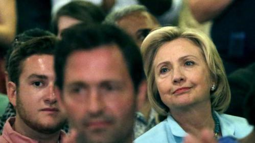 Democratic presidential candidate Hillary Rodham Clinton, listens with the crowd while fellow Democratic presidential candidate, former Maryland Gov. Martin O'Malley, speaks at the Iowa Democratic Wing Ding at the Surf Ballroom Friday, Aug. 14, 2015, in Clear Lake, Iowa. (AP Photo/Charlie Riedel)