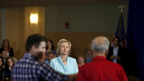 United States Democratic presidential candidate Hillary Clinton listens to a question from a man in the audience during a town hall meeting about college affordability in Dubuque, Iowa, August 14, 2015. REUTERS/Joshua Lott
