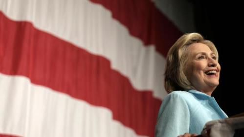 FILE- In this Aug. 14, 2015, photo, Democratic presidential candidate Hillary Rodham Clinton speaks at the at the Iowa Democratic Wing Ding at the Surf Ballroom in Clear Lake, Iowa. President Barack Obama and Clinton are expected to attend Vernon Jordan's 80th birthday party Saturday, Aug. 15,t on the swanky Massachusetts island famous as a gathering spot for prominent Democratic figures. (AP Photo/Charlie Riedel, File)