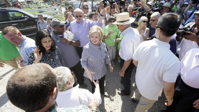 Democratic presidential candidate Hillary Rodham Clinton greets fairgoers during a visit to the Iowa State Fair, Saturday, Aug. 15, 2015, in Des Moines, Iowa. (AP Photo/Charlie Neibergall)