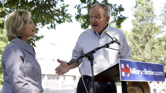 United States Democratic presidential candidate Hillary Clinton is introduced by former United States Senator Tom Harkin (R) during a news conference at the Iowa State Fair in Des Moines, Iowa August 15, 2015. REUTERS/Joshua Lott