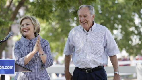 Democratic presidential candidate Hillary Rodham Clinton laughs with former U.S. Sen. Tom Harkin, right, during a visit to the Iowa State Fair, Saturday, Aug. 15, 2015, in Des Moines, Iowa. (AP Photo/Charlie Neibergall)