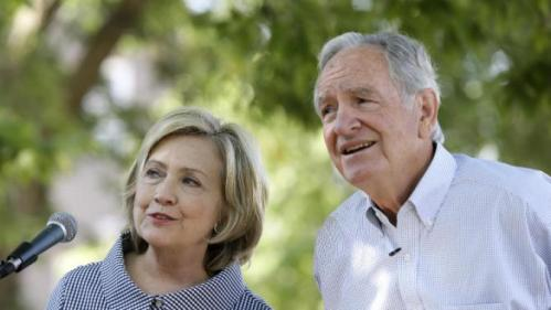 Democratic presidential candidate Hillary Rodham Clinton talks with former U.S. Sen. Tom Harkin, right, during a visit to the Iowa State Fair, Saturday, Aug. 15, 2015, in Des Moines, Iowa. (AP Photo/Charlie Neibergall)