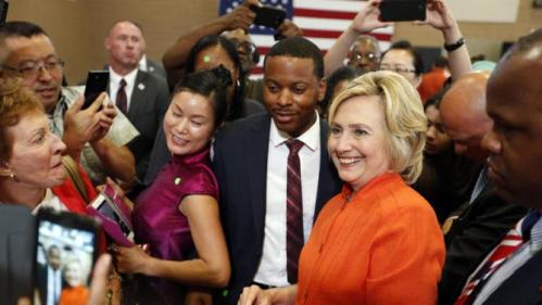 Democratic presidential candidate Hillary Rodham Clinton poses with people at a town hall meeting Tuesday, Aug. 18, 2015, in North Las Vegas, Nev. (AP Photo/John Locher)