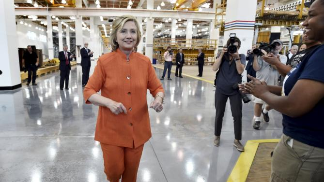 Democratic presidential candidate Hillary Clinton walks over to greet union members as she tours the Carpenters International Training Center in Las Vegas, Nevada August 18, 2015. REUTERS/David Becker