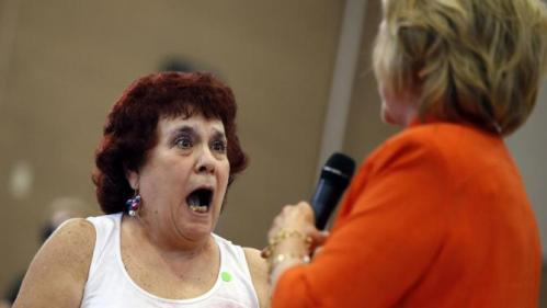 A woman reacts to meeting Democratic presidential candidate Hillary Rodham Clinton during a town hall meeting Tuesday, Aug. 18, 2015, in North Las Vegas, Nev. (AP Photo/John Locher)