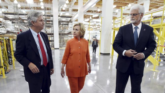 Democratic presidential candidate Hillary Clinton (C) tours the Carpenters International Training Center with Bill Irwin Jr. (L), executive director of the Carpenters International Training Fund, and union president Doug McCarron in Las Vegas, Nevada August 18, 2015. REUTERS/David Becker