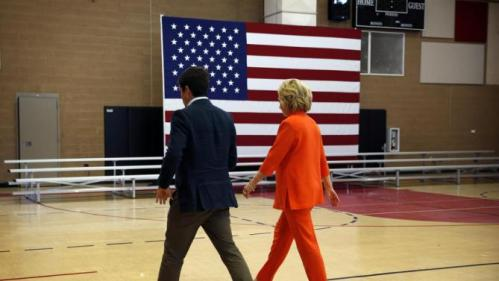 Democratic presidential candidate Hillary Rodham Clinton, right, walks to her vehicle after speaking at a news conference Tuesday, Aug. 18, 2015, in North Las Vegas, Nev. (AP Photo/John Locher)