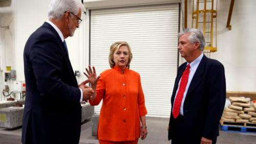 Democratic presidential candidate Hillary Rodham Clinton, center, speaks with Doug McCarron, president of the United Brotherhood of Carpenters and Joiners of America, left, and Bill Irwin Jr., Executive Director of the Carpenters International Training Center, right, while touring the Carpenters International Training Center Tuesday, Aug. 18, 2015, in Las Vegas. The training center was one of several places Clinton visited in the Las Vegas area on Tuesday. (AP Photo/John Locher)
