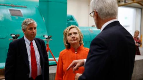 Democratic presidential candidate Hillary Rodham Clinton, center, speaks with Doug McCarron, president of the United Brotherhood of Carpenters and Joiners of America, right, and Bill Irwin Jr., Executive Director of the Carpenters International Training Center, while touring the Carpenters International Training Center Tuesday, Aug. 18, 2015, in Las Vegas. The training center was one of several places Clinton visited in the Las Vegas area on Tuesday. (AP Photo/John Locher)
