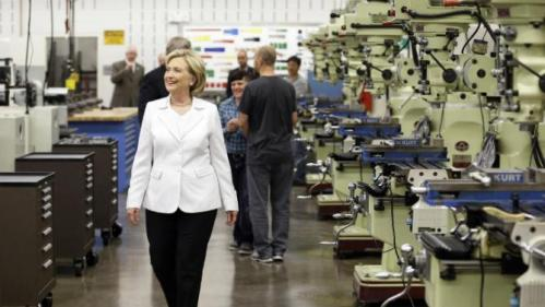 Democratic presidential candidate Hillary Rodham Clinton tours the Tool and Die Lab at the Des Moines Area Community College, Wednesday, Aug. 26, 2015, in Ankeny, Iowa. (AP Photo/Charlie Neibergall)