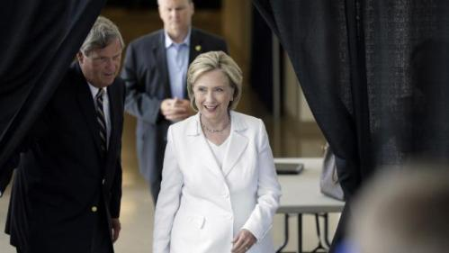 Democratic presidential candidate Hillary Rodham Clinton, followed by Agriculture Secretary Tom Vilsack, left, arrives to speaks about rural issues at the Des Moines Area Community College, Wednesday, Aug. 26, 2015, in Ankeny, Iowa. (AP Photo/Charlie Neibergall)