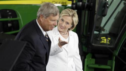 Democratic presidential candidate Hillary Rodham Clinton, accompanied by Agriculture Secretary Tom Vilsack, gestures before speaking about rural issues at the Des Moines Area Community College, Wednesday, Aug. 26, 2015, in Ankeny, Iowa. (AP Photo/Charlie Neibergall)