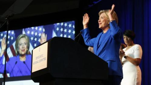 Democratic presidential candidate, Hillary Rodham Clinton, gestures as she addresses the summer meeting of the Democratic National Committee, Friday, Aug. 28, 2015, in Minneapolis. (AP Photo/Jim Mone)