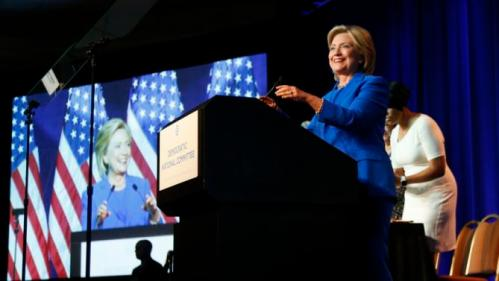 Democratic presidential candidate, Hillary Rodham Clinton, addresses the summer meeting of the Democratic National Committee, Friday, Aug. 28, 2015, in Minneapolis. (AP Photo/Jim Mone)