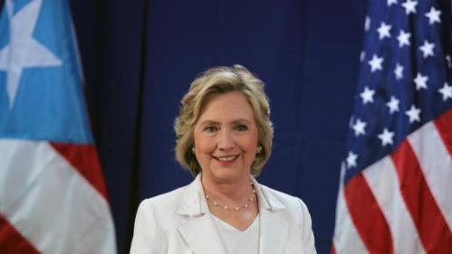 Democratic presidential candidate Hillary Rodham Clinton listens to a question during a news conference after a roundtable to discuss the health care crisis in San Juan, Puerto Rico, Friday, Sept. 4, 2015. (AP Photo/Ricardo Arduengo)