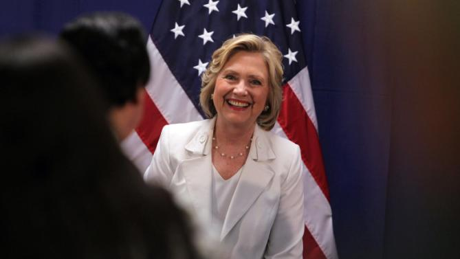 Democratic presidential candidate Hillary Rodham Clinton smiles after a news conference after a roundtable to discuss the health care crisis in San Juan, Puerto Rico, Friday, Sept. 4, 2015. (AP Photo/Ricardo Arduengo)