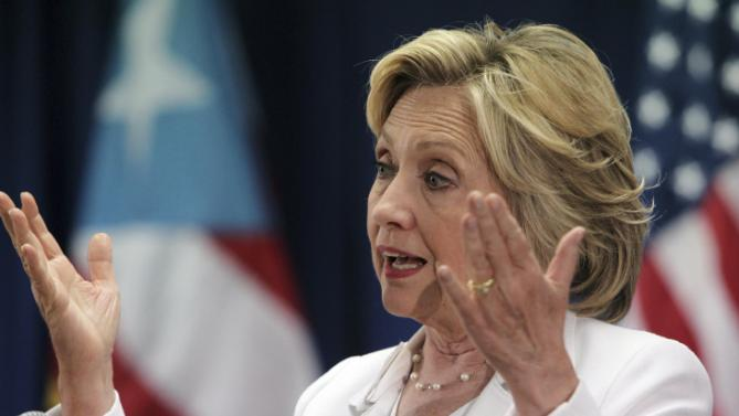 Democratic presidential candidate Hillary Rodham Clinton speaks at a news conference after a roundtable to discuss the health care crisis in San Juan, Puerto Rico, Friday, Sept. 4, 2015. (AP Photo/Ricardo Arduengo)