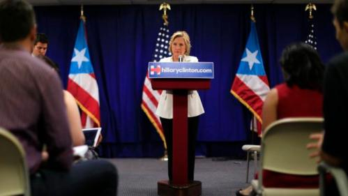 Democratic presidential candidate Hillary Rodham Clinton attends a news conference after a roundtable to discuss the health care crisis, in San Juan, Puerto Rico, Friday, Sept. 4, 2015. Clinton, who won Puerto Rico's 2008 Democratic primary election, defended her support for giving Puerto Rico bankruptcy protection during the round-table discussion focused on the island's health-care problems. (AP Photo/Ricardo Arduengo)
