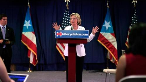 Democratic presidential candidate Hillary Rodham Clinton speaks during a news conference after a roundtable to discuss the health care crisis, in San Juan, Puerto Rico, Friday, Sept. 4, 2015. Clinton, who won Puerto Rico's 2008 Democratic primary election, defended her support for giving Puerto Rico bankruptcy protection during the round-table discussion focused on the island's health-care problems. (AP Photo/Ricardo Arduengo)