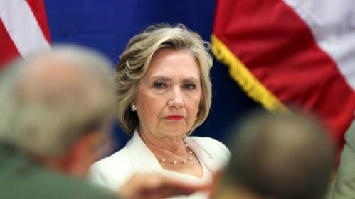 U.S. Democratic presidential candidate Hillary Clinton listens during a roundtable on healthcare in San Juan, Puerto Rico, September 4, 2015. Clinton is campaigning in Puerto Rico the same day that Republican contender Marco Rubio is visiting. While Puerto Rico's residents will not be eligible to cast presidential votes in November 2016, they have a voice in the primaries and, as the island's economy has suffered, an increasing number have moved to U.S. states where they can vote, particularly Florida. REUTERS/Alvin Baez