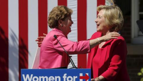 U.S. Democratic presidential candidate Hillary Clinton (R) and U.S. Senator Jeanne Shaheen (L) hug after Senator Shaheen endorsed Clinton at a campaign rally in Portsmouth, New Hampshire September 5, 2015. REUTERS/Brian Snyder