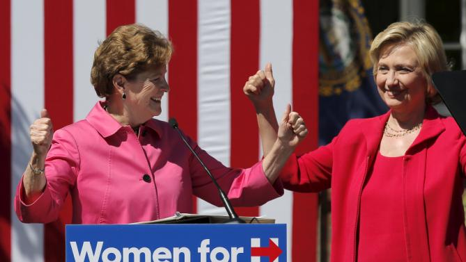 U.S. Democratic presidential candidate Hillary Clinton (R) and U.S. Senator Jeanne Shaheen (L) stand together as Senator Shaheen endorsed Clinton at a campaign rally in Portsmouth, New Hampshire September 5, 2015. REUTERS/Brian Snyder