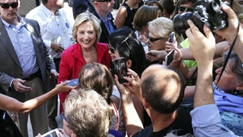 Democratic presidential candidate Hillary Rodham Clinton has pictures taken with supporters as she leaves after being endorsed by Sen. Jeanne Shaheen, D-N.H., during the kick-off event for New Hampshire Women for Hillary in Portsmouth, N.H., Saturday, Sept. 5, 2015. (AP Photo/Cheryl Senter)