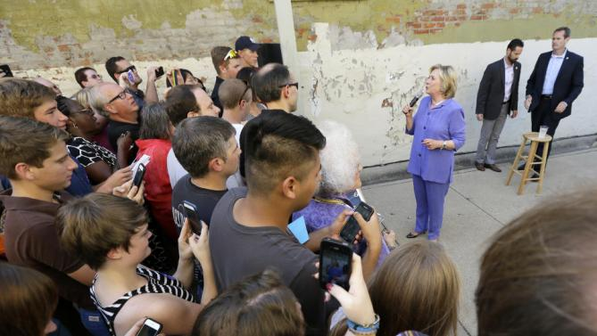 Democratic presidential candidate Hillary Rodham Clinton speaks to supporters in an overflow area outside a campaign stop at Uncle Nancy's Coffee House, Sunday, Sept. 6, 2015, in Newton, Iowa. (AP Photo/Charlie Neibergall)