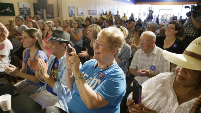 Audience members listen as Democratic presidential candidate Hillary Rodham Clinton speaks during a campaign stop at Uncle Nancy's Coffee House, Sunday, Sept. 6, 2015, in Newton, Iowa. (AP Photo/Charlie Neibergall)