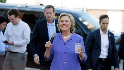 Democratic presidential candidate Hillary Rodham Clinton greets supporters in an overflow area outside a campaign stop at Uncle Nancy's Coffee House, Sunday, Sept. 6, 2015, in Newton, Iowa. (AP Photo/Charlie Neibergall)