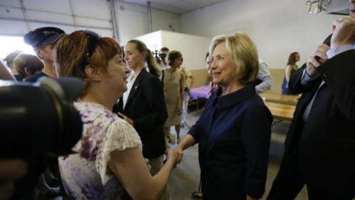 Democratic presidential candidate Hillary Rodham Clinton greets a supporter during the Annual Hawkeye Labor Council AFL-CIO Labor Day picnic, Monday, Sept. 7, 2015, in Cedar Rapids, Iowa. (AP Photo/Charlie Neibergall)