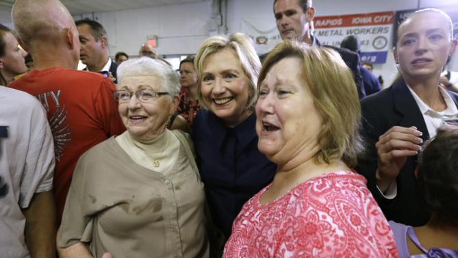 Democratic presidential candidate Hillary Rodham Clinton poses for a photo with Vera Underwood, left, and Sharla Sutton, both of Marion, Iowa, during the Annual Hawkeye Labor Council AFL-CIO Labor Day picnic, Monday, Sept. 7, 2015, in Cedar Rapids, Iowa. (AP Photo/Charlie Neibergall)