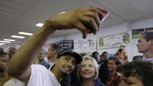 Democratic presidential candidate Hillary Rodham Clinton poses for a photo with a supporter during the Annual Hawkeye Labor Council AFL-CIO Labor Day picnic, Monday, Sept. 7, 2015, in Cedar Rapids, Iowa. (AP Photo/Charlie Neibergall)