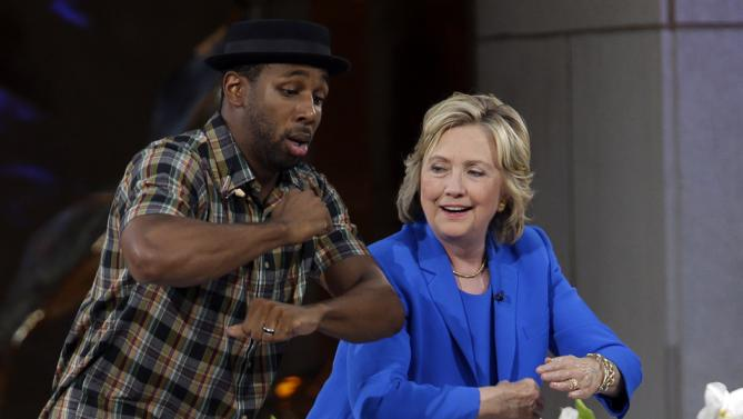 "Democratic presidential candidate Hillary Rodham Clinton, center, practices her dance moves with DJ Stephen ""tWitch"" Boss during a break in the taping of The Ellen DeGeneres Show, Tuesday, Sept. 8, 2015, at Rockefeller Center in New York. (AP Photo/Mary Altaffer)"