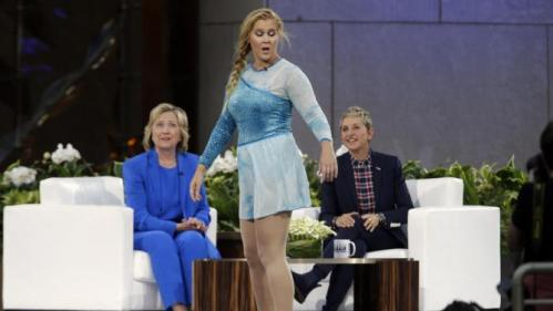 Actress Amy Schumer, center, skates past Democratic presidential candidate Hillary Rodham Clinton as she speaks to Ellen DeGeneres during a taping of The Ellen DeGeneres Show, Tuesday, Sept. 8, 2015, at Rockefeller Center in New York. (AP Photo/Mary Altaffer)
