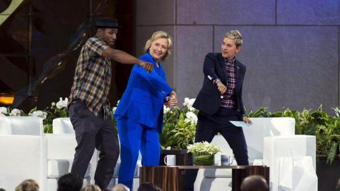 "U.S. Democratic presidential candidate Hillary Clinton dances with DJ Stephen ""Twitch"" Boss (L) and television host Ellen Degeneres (R) during a taping of ""The Ellen Degeneres Show"" in New York September 8, 2015. REUTERS/Lucas Jackson"