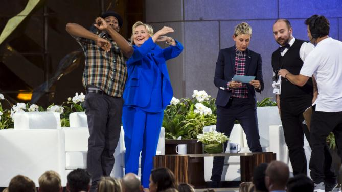 "U.S. Democratic presidential candidate Hillary Clinton dances with DJ Stephen ""Twitch"" Boss (L) next to television host Ellen Degeneres (R) during a taping of ""The Ellen Degeneres Show"" in New York September 8, 2015. REUTERS/Lucas Jackson"