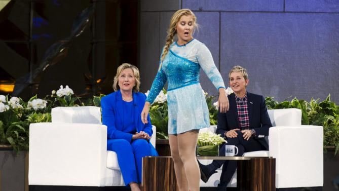 "U.S. Democratic presidential candidate Hillary Clinton and television host Ellen Degeneres (R) look at comedian Amy Schumer during a taping of ""The Ellen Degeneres Show"" in New York September 8, 2015. REUTERS/Lucas Jackson"