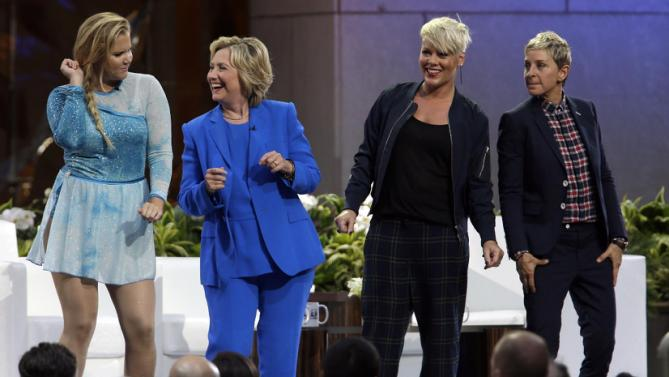 Actress Amy Schumer, left, Democratic presidential candidate Hillary Rodham Clinton, second from left, Ellen DeGeneres and musician Pink dance on stage during a taping of The Ellen DeGeneres Show, Tuesday, Sept. 8, 2015, at Rockefeller Center in New York. (AP Photo/Mary Altaffer)