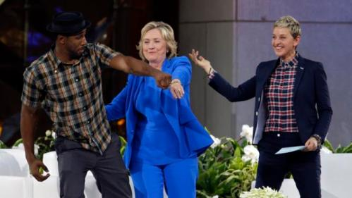 "Democratic presidential candidate Hillary Rodham Clinton, center, practices her dance moves with DJ Stephen ""tWitch"" Boss and Ellen DeGeneres during a break in the taping of The Ellen DeGeneres Show, Tuesday, Sept. 8, 2015, at Rockefeller Center in New York. (AP Photo/Mary Altaffer)"